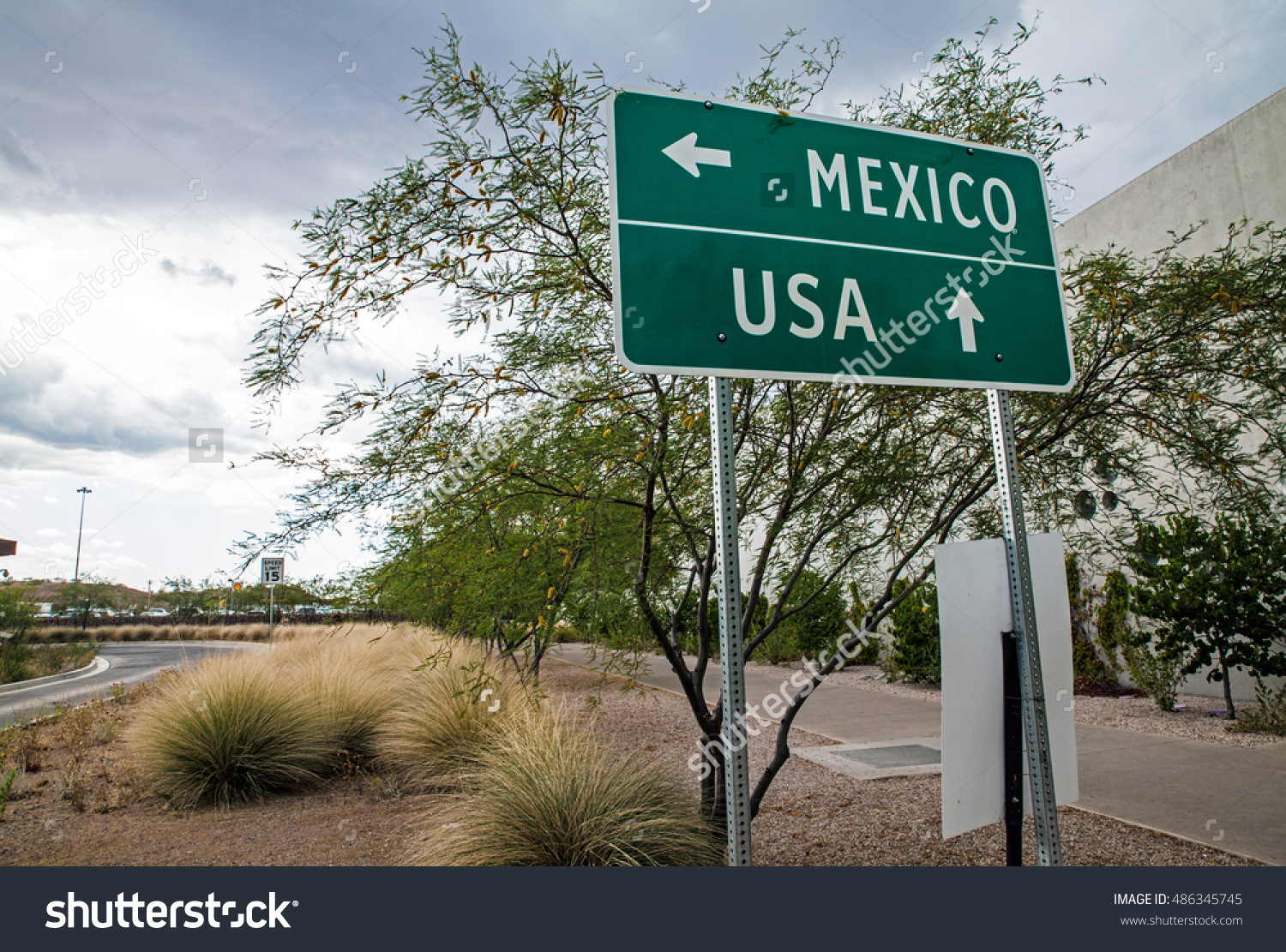 stock-photo-signpost-at-the-us-mexican-border-486345745